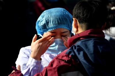 coronavirus cina mascherina donna fg ipa
